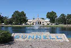 Bunnell Coquina City Hall - Distant Full Front View with Lake Lucille & Fountain.jpg
