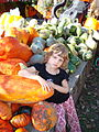 Caitlin with gourds.JPG
