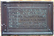 """The bronze plaque on the monument to Camus, built in the small town of Villeblevin, France. The plaque reads: """"From the Yonne area's local council, in tribute to the writer Albert Camus who was watched over in the Villeblevin town hall in the night of January 4 – 5 January 1960."""""""
