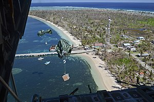 Operation Christmas Drop - Image: Cargo drops from a U.S. Air Force C 130 Hercules aircraft over the Pacific Ocean toward a landing zone on the shore of Kayangel Island during the 62nd annual Operation Christmas Drop Dec. 11, 2013 131211 F NA975 171