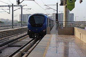 Chennai Metro - A train arriving at the Koyambedu metro station.