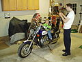 Child sitting on Honda Magna in garage.jpg
