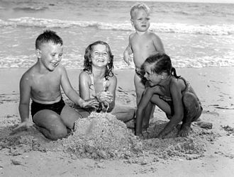 Humor research - Children playing in the sand in Florida, United States