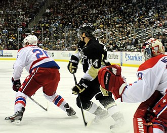 Screen (ice hockey) - Chris Kunitz of the Pittsburgh Penguins screens Washington Capitals goaltender Michal Neuvirth.