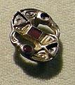 Cividale, man, fibula a S in argento dorato, da necropoli cella 13 con granati almandini.jpg