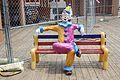 Clown on a Bench (9137016421).jpg