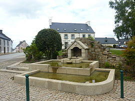 The modern fountain, with the town hall in the background, in Collorec