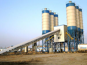 Concrete plant - A typical non-North American design of concrete plant.  Longer conveyors and screw-fed cementitious materials slow down production significantly.