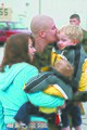 Corporal and airframe mechanic embraces his family after returning from a tour through Western Pacific.jpg