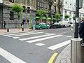 Crosswalk striping style alternates full zebra stripes and edge squares (18185525364).jpg