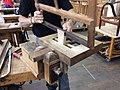 Découpe de la pièce de bois pour la réalisation du tenon à l'aide de la scie à cadre - Mobilier national.jpg