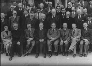 Dublin Institute for Advanced Studies - Photo taken at DIAS in 1942 First row from left:  Sheila Tinney, Pádraig de Brún, Paul Dirac, Éamon de Valera, Arthur W. Conway, Arthur Eddington, Erwin Schrödinger, Albert Joseph McConnell