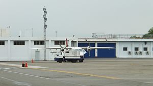 Daily Air Do 228 Charging by Generator Truck at Taitung Airport Apron 20120324.jpg
