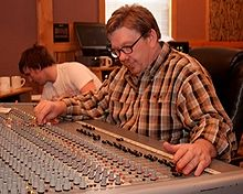 A picture of David R. Ferguson at a mixing board.
