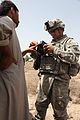 Defense.gov News Photo 100403-A-1786S-052 - U.S. Army Spc. Patrick McDougall of 2nd Squadron Bravo Company 7th Cavalry Regiment uses a Hand-held Interagency Identity Detection Equipment.jpg