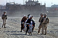 Defense.gov News Photo 101224-M-0901H-174 - U.S. Marine Cpl. John Noh speaks to local Afghans during a patrol in Musa Qal eh Afghanistan on Dec. 24 2010. Noh is assigned to the 1st.jpg