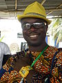 Degbe Agessou with sunglasses and yellow hat.jpg