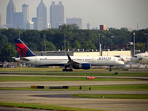 Hartsfield–Jackson Atlanta International Airport - A Delta Boeing 757-200 with the Atlanta skyline in background.