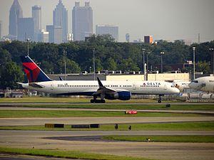 Hartsfield–Jackson Atlanta International Airport - A Delta Boeing 757-200 with the Atlanta skyline in background.