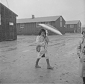 Executive Order 9066 - A girl detained in Arkansas walks to school in 1943.