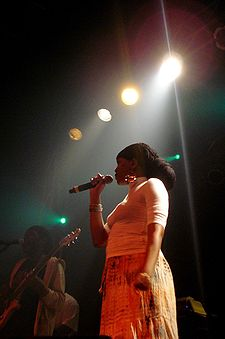 Dezarie singing on stage.