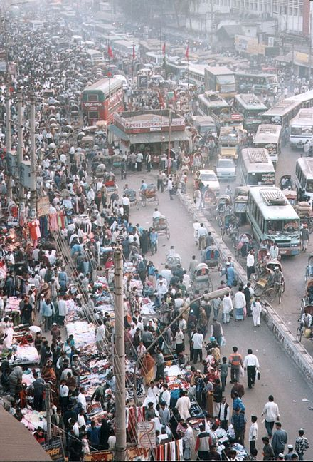 Dhaka, Bangladesh in 2006. Almost 97% of future population growth will occur in developing countries. Dhaka street crowds.jpg