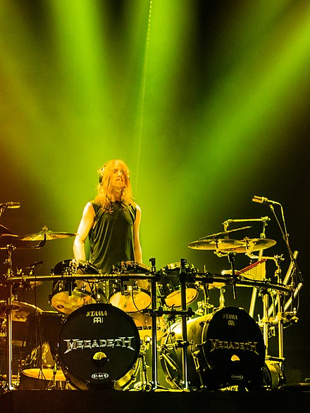 Drummer Dirk Verbeuren joined the band in 2016, replacing Chris Adler. Dirk Verbeuren on stage with Megadeth at The O2, London, 2018-06-16.jpg