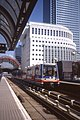 Docklands Light Railway - The DLR Heron Quays Station with Canary Wharf 29 July 1991.jpg