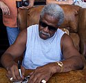 A picture of Earl Campbell on a phone.