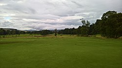 Edzell Golf Club 15th fairway and disused Edzell railway line from 14th green.jpg