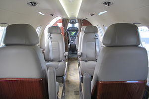 Embraer Phenom 300 - Image: Embraer EMB 505 Phenom 300 cabin forward view