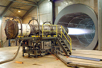 Thrust - A Pratt & Whitney F100 jet engine being tested. This engine produces a jet of gas to generate thrust. Its purpose is to propel a jet airplane.
