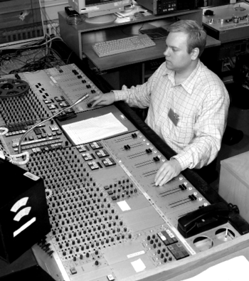 An engineer at one of the audio consoles of the Danish Broadcasting Corporation (Danmarks Radio). The console is an NP-elektroakustik specially made for Danmarks Radio in the eighties.