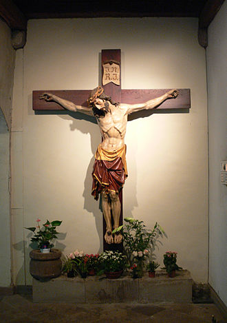 Crucifix - A crucifix, a cross with a representation of Jesus' body, hangs on a wall