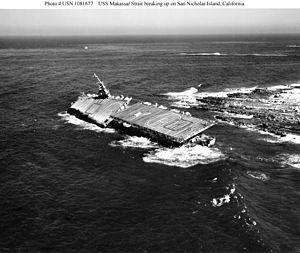 USS Makassar Strait - Ex-USS Makassar Strait (CVU-91) breaking up on San Nicholas Island, California, where she had gone ashore while used as a Pacific Missile Range target ship. Photographed on 22 January 1963.