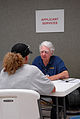 FEMA - 30803 - FEMA worker talk to resident inside a Disaster Recovery Center in Missouri.jpg