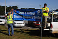 FEMA - 40967 - Tift County Workers Install DRC Sign.jpg