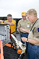 FEMA - 44723 - Members of the Southern Baptist Disaster Relief division prepare their equipment.jpg