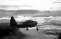 Fairchild PT-26 flight in clouds (4677862584).jpg