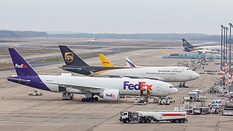 Air cargo - A FedEx Boeing 777F, an UPS Boeing 747-400F and a DHL tail