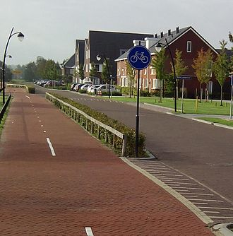 Cycling infrastructure - This Fietspad or Bicycle Path is in the Netherlands safely linking housing with decent street lights.