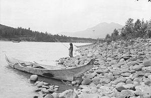 Skeena River - First Nations girl fishing on the Skeena River near Kitwanga, 1915