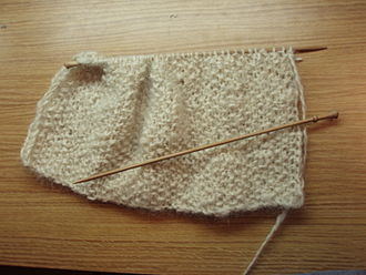 Flat knitting - A scarf knitted using flat knitting on single pointed needles