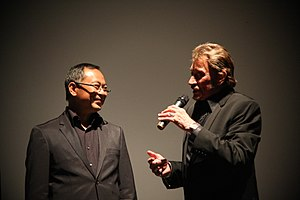 Johnnie To et Johnny Hallyday lors d'une projection du film Vengeance.