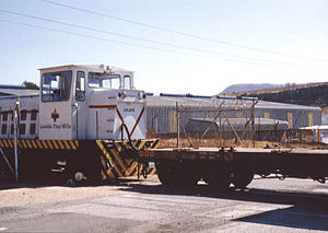 Rail transport in Lesotho - Diesel engine with goods wagon of Lesotho Flour Mills at Maseru station