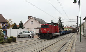 Street running - A WLB freight train in Guntramsdorf
