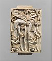 Furniture plaque carved in relief with a striding, ram-headed sphinx supported by two kneeling figures MET DP110692.jpg