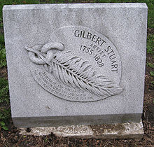 "Marble plaque with an outlay of a feather linked to a piece of chain, and the name ""Gilbert Stuart"" carved on it."