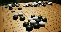 https://upload.wikimedia.org/wikipedia/commons/thumb/2/2e/Go_board.jpg/250px-Go_board.jpg