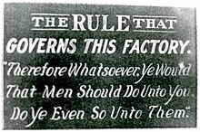 """Golden Rule Sign"" that hung above the door of the employee's entrance to the Acme Sucker Rod Factory in Toledo, Ohio, 1913. The business was owned by Toledo Mayor Samuel M. Jones."